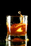 Whiskey splash Royalty Free Stock Photography