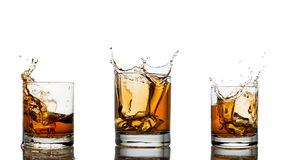 Whiskey splash in a glass, isolated, white Royalty Free Stock Images