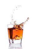 Whiskey splash in a glass Royalty Free Stock Photo