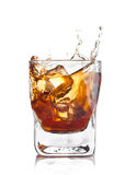 Whiskey splash with ice cubes Stock Photography