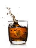 Whiskey splash. With ice cubes isolated on white Stock Photo