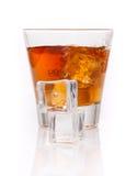 Whiskey splash with ice cubes isolated on white Stock Photography