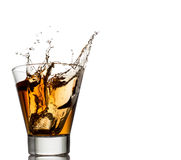 Whiskey splash with ice cubes isolated on white Royalty Free Stock Photos