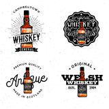Whiskey themed logotypes. Badges, labels, logos, design elements, based on cartoon detailed whiskey bottle Royalty Free Stock Image