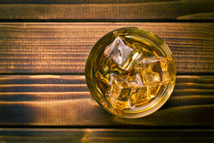 Whiskey. Top view of whiskey in glass with ice royalty free stock image