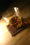 Whiskey Tumbler on Mat. Whiskey in tumbler on mat Stock Image