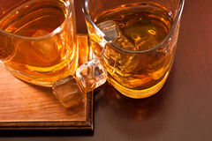 Whiskey. Two glasses of whiskey with ice cubes Royalty Free Stock Image