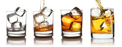 Whiskey in vetro con l'insieme del ghiaccio Fotografia Stock Libera da Diritti