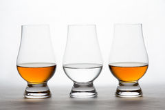 Whiskey and Vodka in Crystal Tasting Glasses Stock Photos