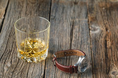 Whiskey and watch Royalty Free Stock Photos