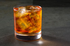 Whiskey whisky on the rocks on glass Royalty Free Stock Images