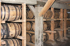 Whiskey or wine aging in barrels Stock Photo
