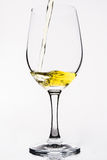 Whiskey in a  wine glass isolated on white - Yellow. Whiskey in a  wine glass isolated on white Royalty Free Stock Image