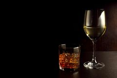 Whiskey and Wine. Whisky or whiskey is a type of distilled alcoholic beverage made from fermented grain mash. Various grains (which may be malted) are used for Royalty Free Stock Photo