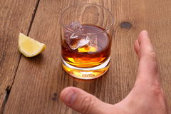 Whiskey With Ice Cubes In Glass And Grab Hand Royalty Free Stock Photos