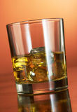 Whiskey With Ice Cubes On Red Royalty Free Stock Images