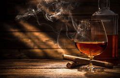 Whiskey With Smoking Cigar Royalty Free Stock Images