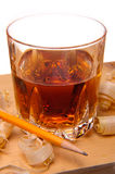 Whiskey and wood. Glass of whiskey among wood shavings Stock Images