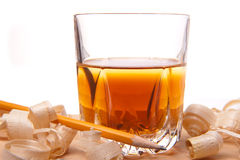 Whiskey and wood. Glass of whiskey with wood shavings Stock Photography