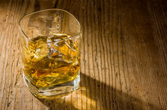 Whiskey on a wooden background Stock Photo