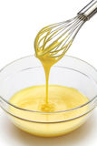 Whisking egg yolks and sugar in a bowl Royalty Free Stock Photography