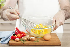 Whisking eggs in bowl Royalty Free Stock Images