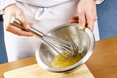 Whisking vigorously to disperse oil Making Mayonnaise oil royalty free stock photos