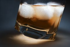 Whisky. Ice blocks in whisky, Scotch Royalty Free Stock Photo