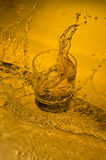 Whisky. Class of  whisky on creative brown background with water Stock Photography
