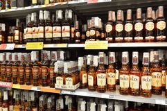 Whisky. Different whiskey bottels in a supermarked rack Royalty Free Stock Photography
