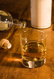 Whisky. Classic malt whisky display in amber colored setting Royalty Free Stock Photography