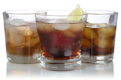 Whisky, alcohol and cola with ice cubes Royalty Free Stock Images