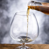 Whisky. Alcoholic beverage whisky glass and bottle Royalty Free Stock Images