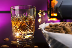 Whisky with almonds Royalty Free Stock Image