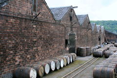 Whisky barrels, Scotland. Whisky barrels outside a old whisky distillery Stock Photos