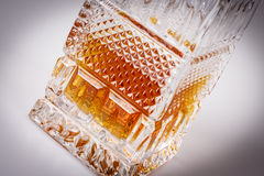 Whisky in beautiful glass bottle, rum, bourbon, cognac, brandy, glassware Royalty Free Stock Photos
