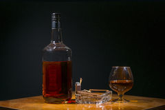 Whisky in bottle and shot glass Stock Photos