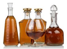 Whisky in bottles and glass Royalty Free Stock Image