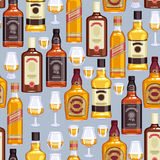 Whisky bottles and glasses background. Stock Photos