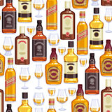 Whisky bottles and glasses background. Stock Photo