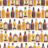 Whisky bottles seamless pattern background. Royalty Free Stock Images
