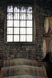Whisky casks at distillery. Whisky casks by window in scotish distillery stock images