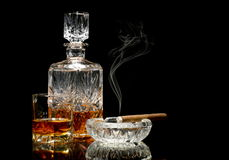 Whisky and a cigar on glossy table Stock Images