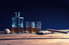 Whisky and cigar on wooden table Stock Photos