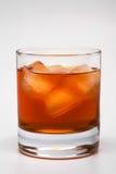 Whisky con un hielo Fotografía de archivo