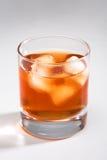 Whisky con un hielo Foto de archivo libre de regalías
