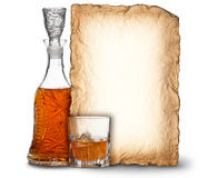 Whisky decanter, glass and blank card Royalty Free Stock Photography