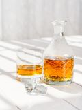 Whisky decanter and rocks glass Royalty Free Stock Images