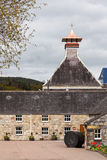 Whisky distillery. Distinctive copper chimney of a whisky distillery in Scotland royalty free stock photos