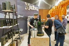 Whisky Dram Festival in Kiev, Ukraine. Unrecognized people visit Ardbeg Single Malt peated Scotch Whisky distillery booth at 3rd Ukrainian Whisky Dram Festival royalty free stock image